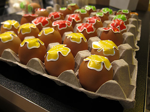 eggs on a counter, the bottoms covered with large, shamrock shaped stickers